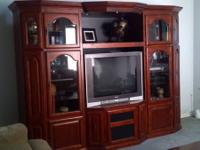 Beautiful Entertainment Center.  A few scratches on TV
