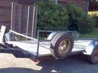 12' x 5' deck, single axle trailer with brakes. No