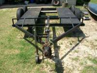 Homemade car trailer. Mobile home axles.Manual winch.