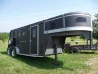 This is a 2 horse gooseneck trailer w/dressing room in