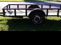 5' x 10' tilt Trailer with new tires and treated boards