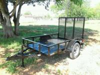 Brand new 5 x 8 gated single axle utility trailer for