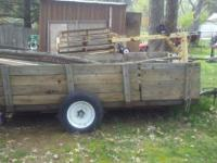 Utility trailer with stake sides, solid steel floor,