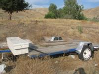 "Trailer flatbed measures 16'4"" by 8. blue in color with"