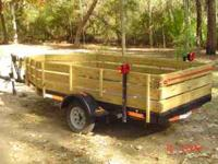 12FOOT TRAILER 5FOOT WIDE AT THE BACK AND IS TAPERED TO