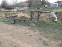 This is an old camper frame with a gooseneck hitch. The