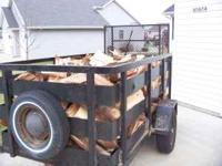 It is a 4x8 trailer with 3 ft sides full of wood. It is