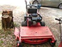 7 1/2 by 16 trailer and two Gravely walk behind mowers;