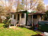 Trailer house, with fenced yard nice land scaping, lots