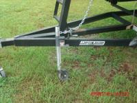 Trailer jack 750 lbs. Works well. Bracket to mount to