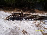 Two solid hinged with load leg trailer ramps .These