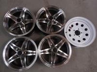 Set of four alloy and one white rim removed from 5th