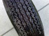 NOT SURE WHAT SIZE IT IS IT IS A 14 INCH RIM TIRE IS