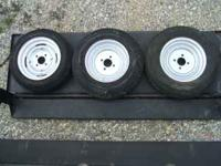 2 trailer tires on 4 bolt rims. 5.30 x 12, 6 ply. 2.5""