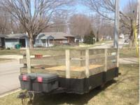 For sale is a trailer with a front end storage box. The