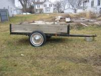 Small single axle trailer. About 3 x 5 feet. Homemade.