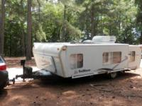 An easy to tow fold down camper, all hard sides no