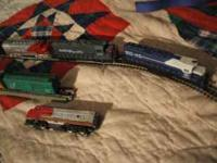 They are Lionel train cars, 3 1/2 to 4 inches long, 5