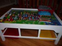 I have a train/play table with six plastic storage bins
