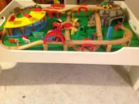 Train table fully assembled with many pieces.