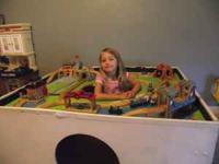 This is a 5 yr old home made train table with a tunnel