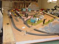 I HAVE A TRAIN SET UP FOR SALE .THERE IS ALMOST $800.00