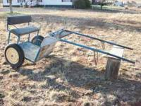 Very sturdy training cart. Pipe construction w/tires.