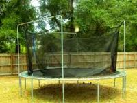 ASKING $150. TRAMPOLINE WITH THE SAFETY NETTING.