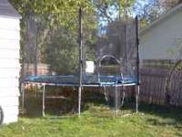 12 foot trampoline with safety net for sale. Good
