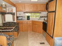 Beautiful 2003, 34 ft., travel trailer set up on