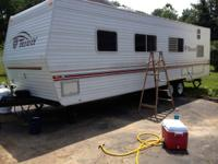 31 foot terry trailer by fleet wood. Year is a 2001 in