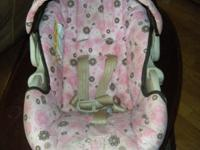 This is a girls brown and pink stroller and carset
