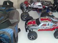 Marketing me traxxas rc trucks. One is a 2.5 nitro