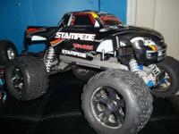Traxxas stampede with team associated brushed system.