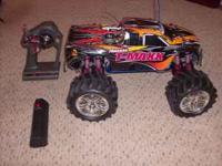 Here is a Traxxas T-Maxx that is as close to brand new