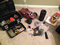 THIS IS A TRAXXAS T-MAX, IT HAS ALL THE UPGRADES AND