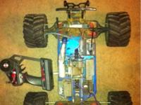 Has a 2.5 motor. Includes controller, 4x4 chassis.