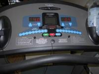 Vision Fitness Model T9450HRT folding treadmill. Has