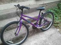 Its a 24 inch tires Trek 220 Series Mountain Track with