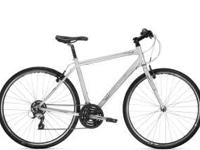 Trek 7.1 FX silver performance hybrid bike. It has a