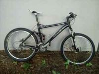 Well maintained full suspension XC mountain bike.