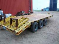 Tri-axle trailer, 16ft bed, 3ft beavertail, ramps. very