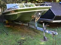 Old 165 Tri Hull boat that we've had parked on our land