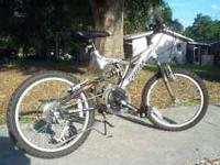 I AM SELLING A TRIAX PK7 MOUNTAIN BIKE 21 SPEED WITH
