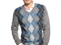 A V-neck argyle sweater by Tricots St Raphael says