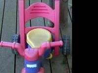 Fisherprice tricycle the handle folds over into a