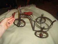 Tricycle plant holder. All metal. Can be used indoors.
