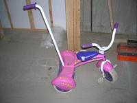 I have a pink and purple tricycle with a handle for mom