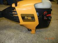 For sale is a Poulan Pro 445 gas-powered pole trimmer.