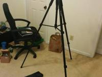 video camera tripod, a few pieces are broken (see